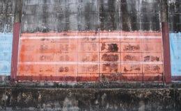 Textura roja y azul de la pared de ladrillo Fotografía de archivo