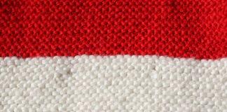 Textura roja y blanca de las lanas de un vestido del invierno hecho a mano Fotos de archivo libres de regalías