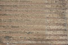 Textura rojiza de los ladrillos de la pared antigua extraña imagen de archivo