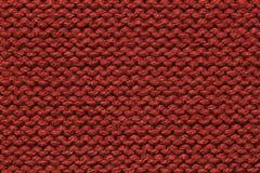 Textura rojo oscuro de las lanas que hace punto para el modelo y el fondo Imagenes de archivo