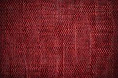 Textura rojo oscuro del lino Foto de archivo libre de regalías