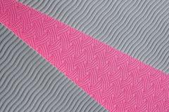 Textura rosada de la estera de la yoga Foto de archivo