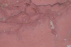 Textura rosada de la pared con la pintura de la peladura Imagenes de archivo