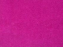 Textura rosada de la toalla, fondo del paño Imagen de archivo libre de regalías