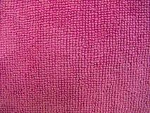 Textura rosada de la toalla, fondo del paño Imágenes de archivo libres de regalías