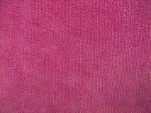 Textura rosada de la toalla, fondo del paño Foto de archivo libre de regalías
