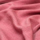 Textura rosada de los géneros de punto Imágenes de archivo libres de regalías