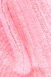 Textura rosada del color de la tela de lana hecha punto para el papel pintado color Fotografía de archivo