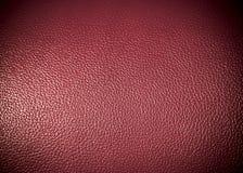 Textura rosada roja de la superficie de la piel sintética como textura del grung del fondo Fotos de archivo libres de regalías