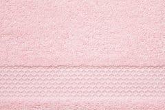Textura rosada suave, mullida de la toalla Hotel, balneario, bathroo cómodo imágenes de archivo libres de regalías
