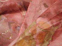 Textura rosada verdadera de la tela de seda Imágenes de archivo libres de regalías
