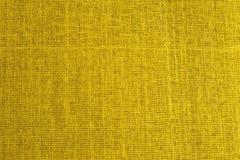 Textura sem emenda de Tileable da superfície amarela da tela Fotografia de Stock Royalty Free