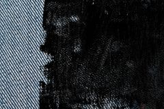 Textura suja da sarja de Nimes do Grunge com a emenda vermelha para o fundo das calças de brim imagem de stock royalty free