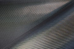 Textura tejida negro de la fibra de carbono Imagen de archivo