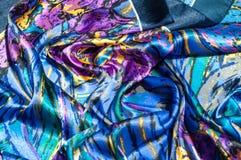 Textura, tela, fondo La bufanda de las mujeres La tela de seda es azul, Imagen de archivo
