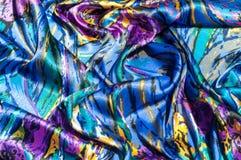 Textura, tela, fondo La bufanda de las mujeres La tela de seda es azul, Foto de archivo libre de regalías