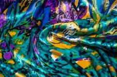 Textura, tela, fondo La bufanda de las mujeres La tela de seda es azul, Fotos de archivo