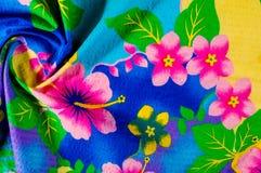 Textura, teste padrão Pano com testes padrões modelados de cores brilhantes Foto de Stock