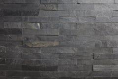 Textura trasera del fondo de la pared de piedra con la iluminación desde arriba del lado Imágenes de archivo libres de regalías