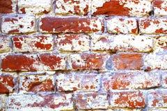Textura velha da parede de tijolo, construção antiga, destruída no tempo Imagens de Stock