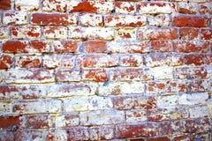 Textura velha da parede de tijolo, construção antiga, destruída no tempo Fotos de Stock