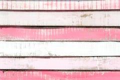Textura velha e fundo de madeira pintados brancos e cor-de-rosa do vintage Foto de Stock