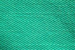 Textura verde de matéria têxtil da sarja de Nimes Fotos de Stock Royalty Free