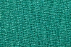 Textura verde del fondo de la tela Detalle del primer del material de materia textil foto de archivo libre de regalías