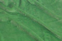 Textura verde do fundo da tela de veludo imagem de stock