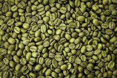 Textura verde dos feijões de café Feche acima da vista, vista superior imagem de stock