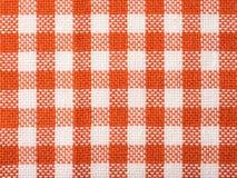 Textura verificada laranja de toalha de cozinha Foto de Stock