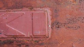 A textura vermelha e oxidada abstrata do metal fotografia de stock