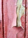 Textura vermelha Exfoliating da pintura imagem de stock royalty free