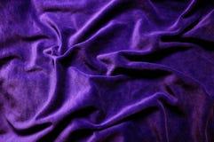 Textura violeta escura do fundo de veludo imagens de stock