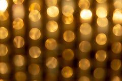 Textura y fondo de la falta de definición del extracto de la luz del oro del círculo Fotos de archivo libres de regalías