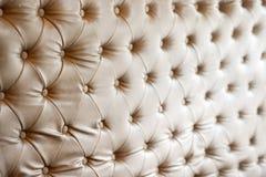 Textura y fondo del sofá del cuero de Brown foto de archivo