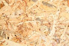 Textura y fondo del tablero de OSB, hechos de los pedazos de madera marrones enarenados en un conglomerado de madera Visión ascen foto de archivo