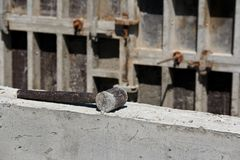 Sledgehammer on concrete, closeup stock images