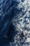 Textural background. Blue waves of the sea.  Royalty Free Stock Image