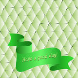 Textural background of bright green paper with. Ribbon and wish a good day Stock Images