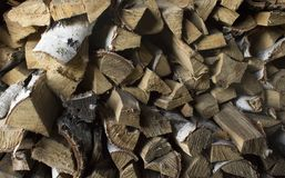 Textural background of chopped and stacked firewood. stock image