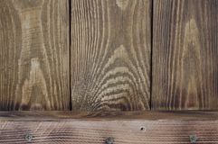 Textural background of wooden boards arranged vertically and one horizontal board. royalty free stock photo
