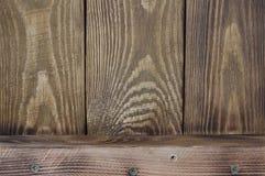 Textural bakgrund av ordnade träbräden vertikalt och ett horisontalbräde royaltyfri foto