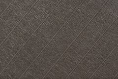 Textural of dark brown background of wavy corrugated paper, closeup stock photos