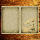 Textural old paper on a wooden background Royalty Free Stock Photos