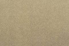 Textural plexus threads of textile fabric beige color Stock Photos