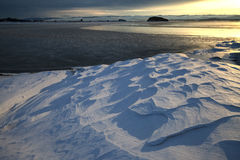 Textural snow along coastline of freezing lake in winter Royalty Free Stock Photography