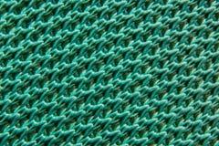 Texturas da fibra verde do macro sintético do tecido fotografia de stock