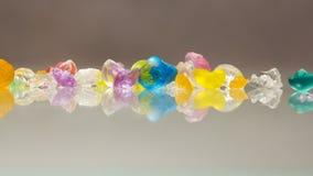 Texturas del extracto de las bolas quebradas de la jalea con reflexiones Foto de archivo libre de regalías