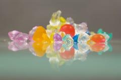 Texturas del extracto de las bolas quebradas de la jalea con reflexiones Imagen de archivo